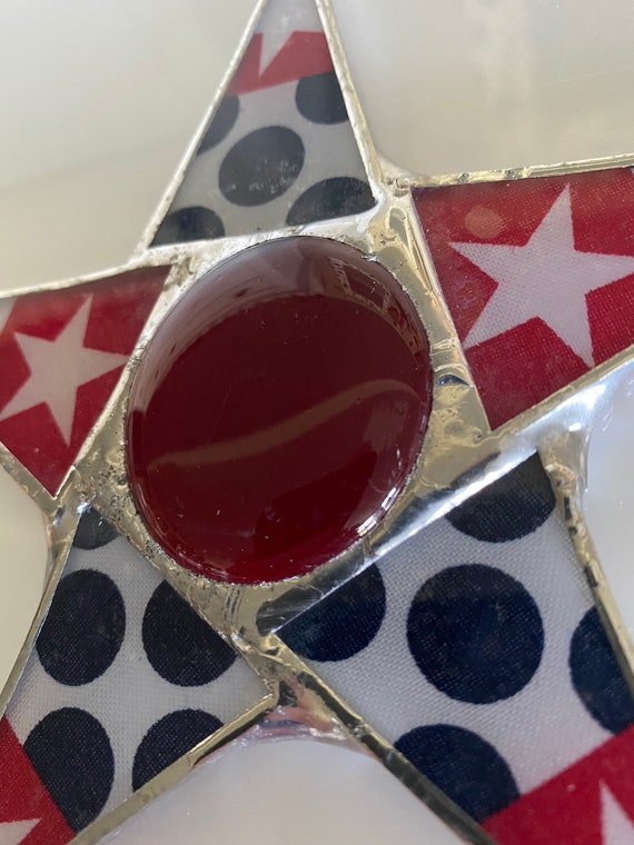 Susan B. Anthony star-- 5.5 inche lacquered fabric under glass