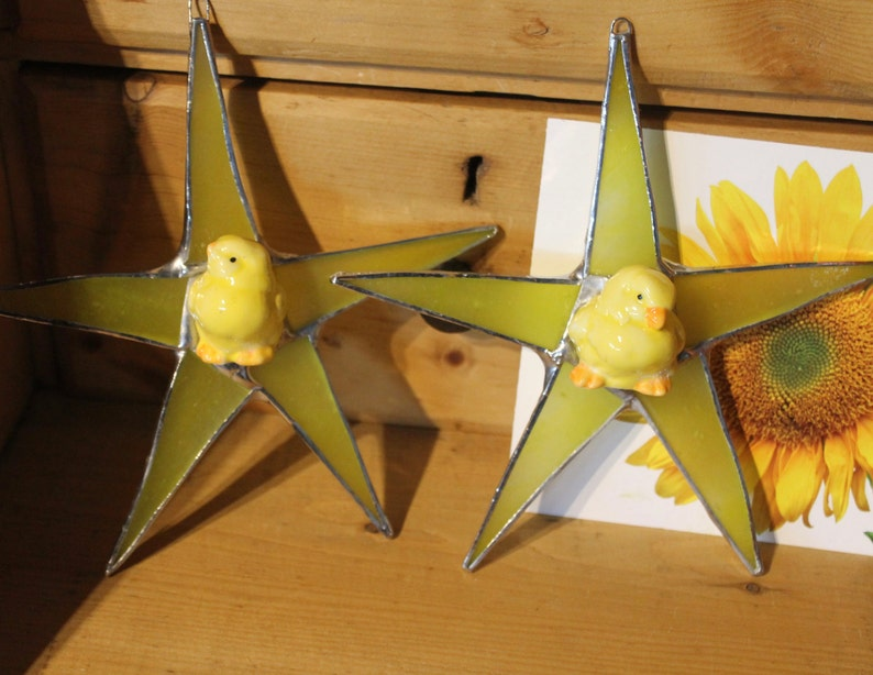 listing for one Chick Star 1 7 inch stained glass star with ceramic chick star