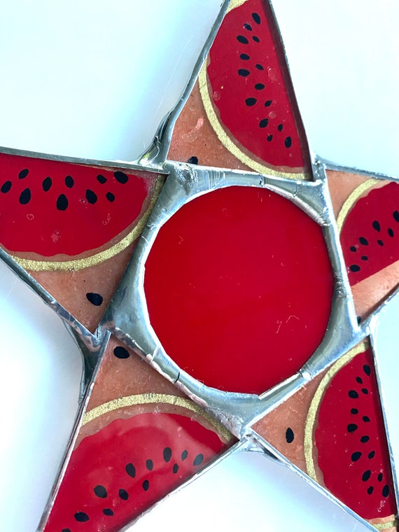 Watermelon Star- 7 inch lacquered paper under glass points with art glass cabochon center