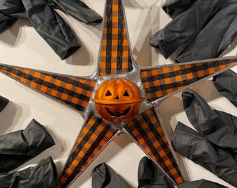Plaid Jack- 7 inch Halloween star with bell Jack-O-Lantern center and lacquered fabric under glass points