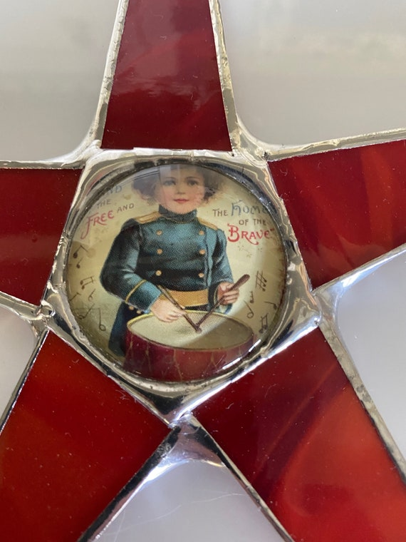 Land of the Free Home of the Brave- 9 inch art glass star with lacquered drummer boy under glass dome