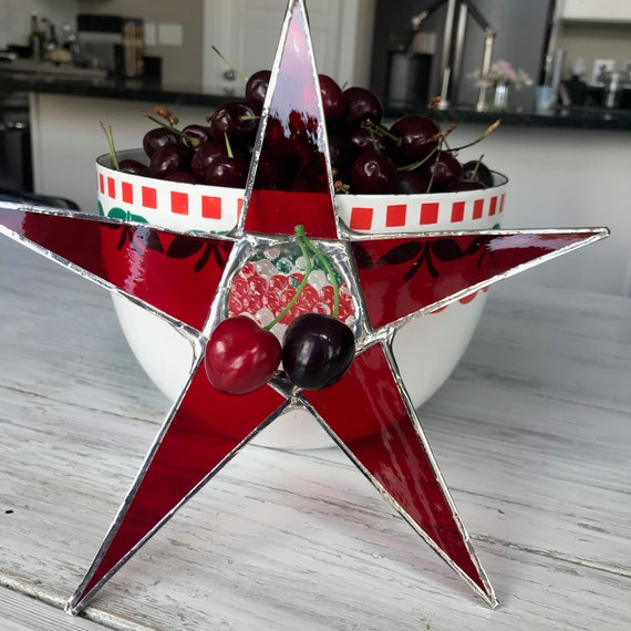 Cherry Star- 9 inch red art glass points with clear patterned glass center and faux cherries