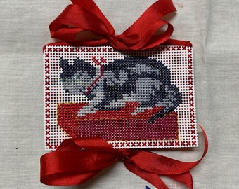 Gray tabby cat on a cushion, punch paper needle book