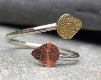 Adjustable silver ring with copper and brass textured leaf: Handmade sterling silver.  One size fits all ring