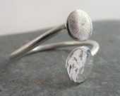Adjustable silver ring wi...
