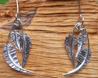 Textured, leaf-shaped silver drop earrings : Handmade, sterling silver