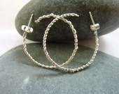 Twisted wire hoop earring...