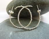 Twisted wire hoop earring...