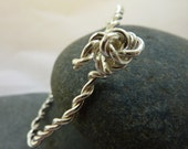 Twisted silver wire stack...