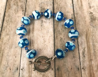 Lamp work bead bracelet lamp work blue and white bubble design with blue Swarovski crystals nautical toggle clasp beach nautical ocean sea
