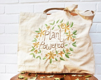 plant powered slogan tote bag recycled calico ( vegan )