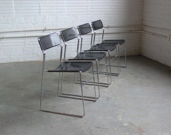Modernist Perforated Metal Stacking Dining Chairs In the Manner of Niels Jorgen Haugesen (Set of 4)