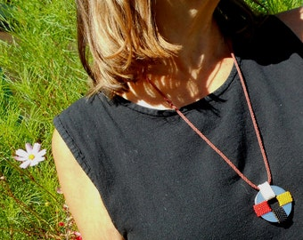 Beadwork pendant necklace in Native American medicine wheel colors beaded on a steel washer