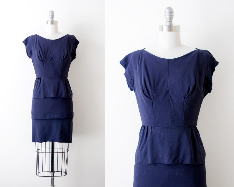 b7b7f231362 50s wiggle dress. Vintage 1950 navy blue dress. Tiered peplum