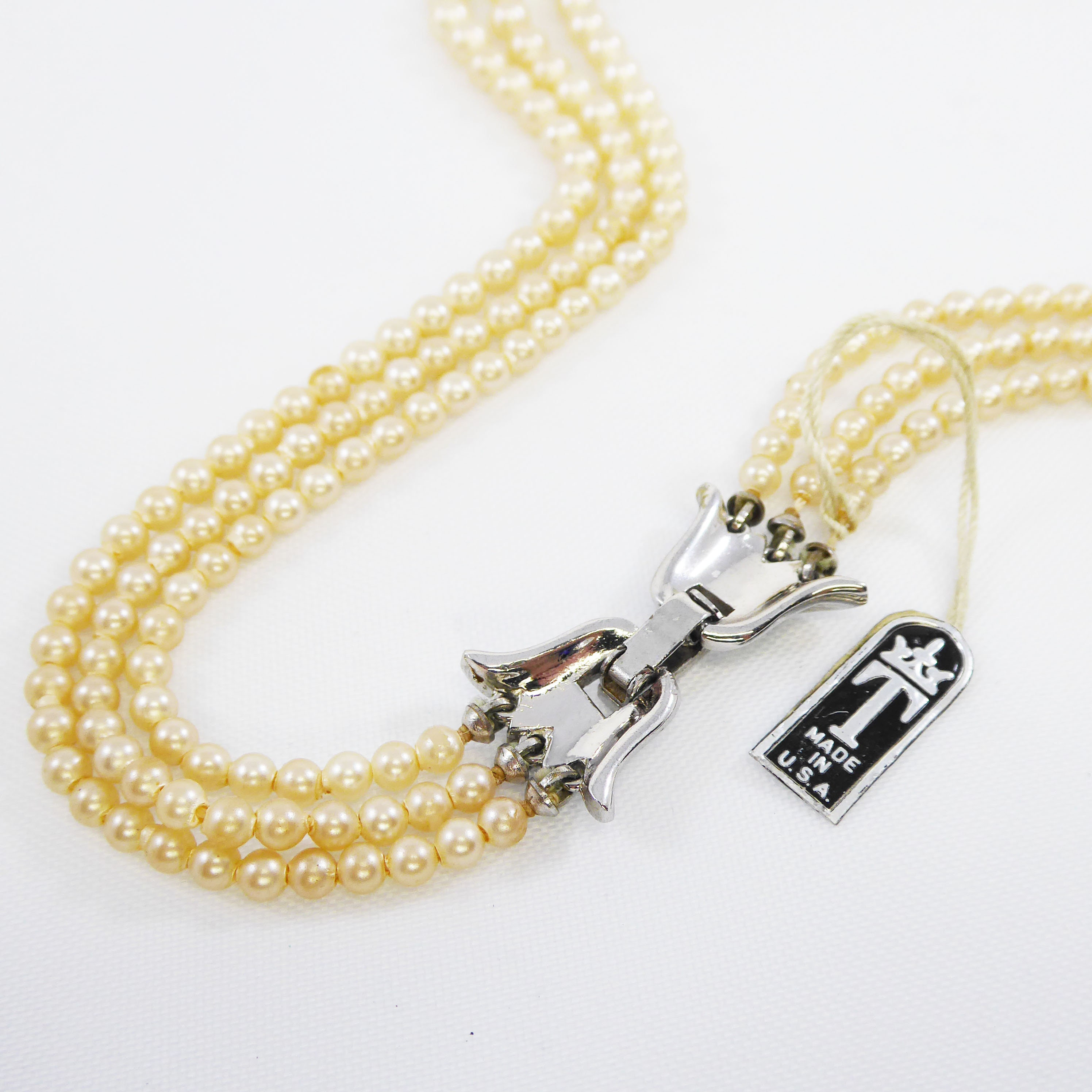 ebb63f16b92e1 Triple Strand Pearlescent White Beaded Necklace Signed Trifari Tulip ...