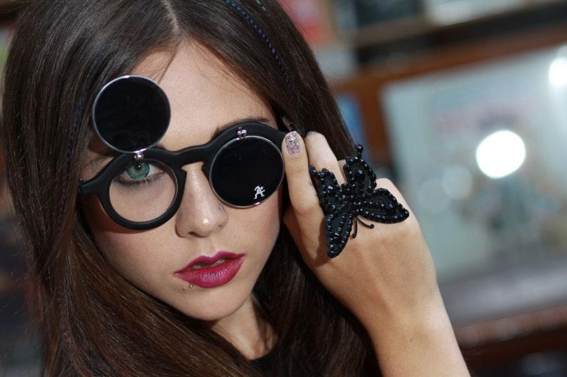 ec677bd2f4 Round sunglasses black plastic frame vintage retro flip up