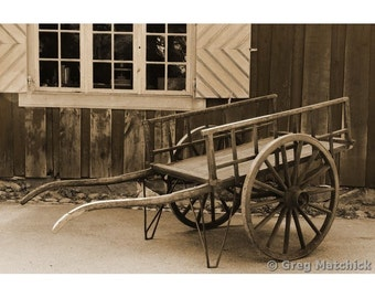 Fine Art Sepia Photography of a Rustic Old Farm Cart in Sweden