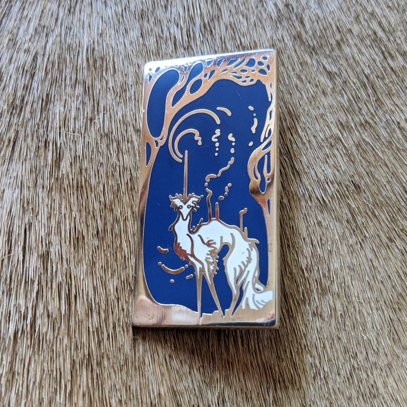 polished silver-finished nickel metal filled with a gorgeous blue and white enamel silken windhound pin The Littlest Unicorn