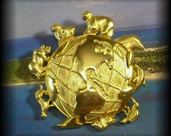 Brilliant Gold Toned World Map Pin With Animals