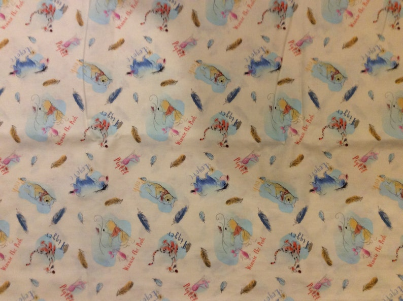 A Disney Classic Pooh And Friends Feathers Tossed Cotton Fabric BTY Free US Shipping
