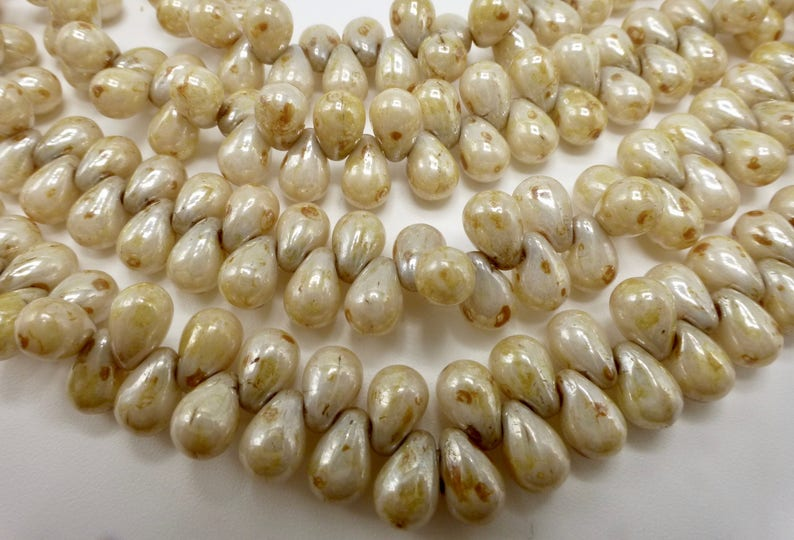 100 Czech Glass Tiny Tear Drop Beads in a Opaque Cream Luster with Picasso Finish Size 4x6mm