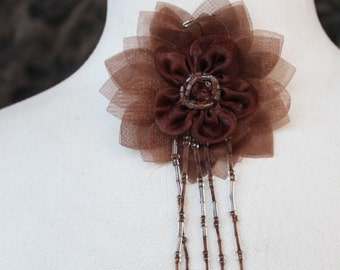 Cute brown  color  flower made from organza  with pin back and beads   1 piece listing