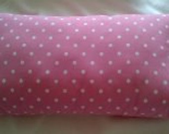 Pretty pink and white spot cushion
