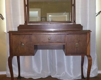 Ladies Vintage Vanity from the 1800's 3 drawers with mirror and glass top.  Very Beautiful and nice pink up only worth the money. Dream Gift
