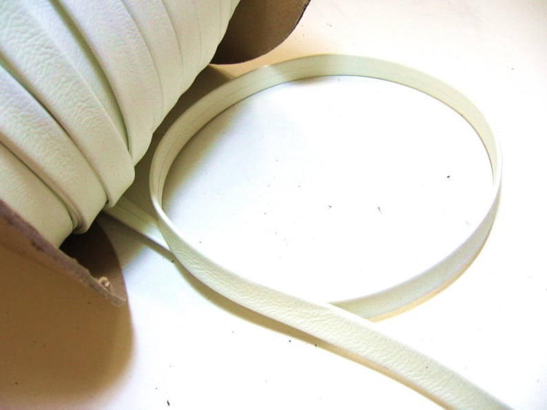 DISCOUNTED ITEM 58 Double-Folded with Reinforcement Damaged Cowhide Strap in Yellowed White 5 YDS 0625RD
