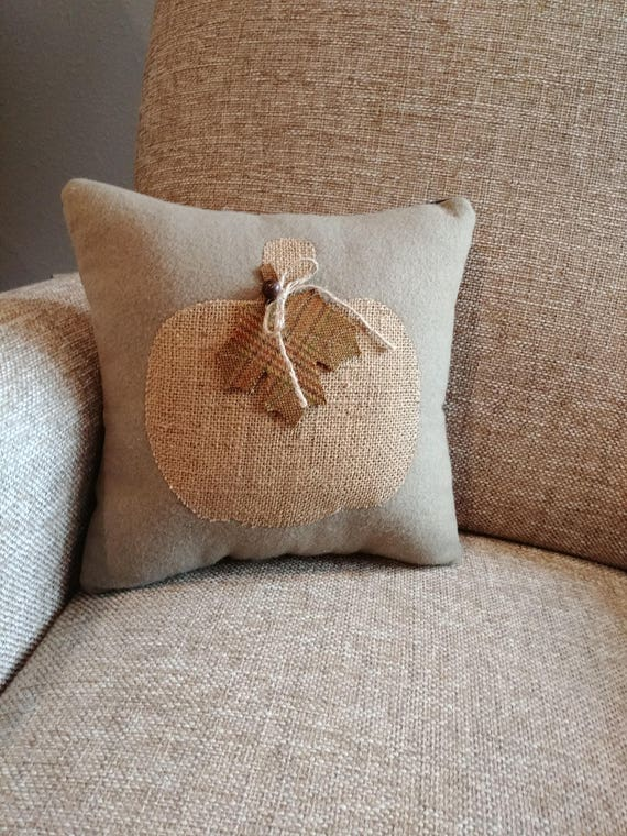 decorative pillow with burlap pumpkin