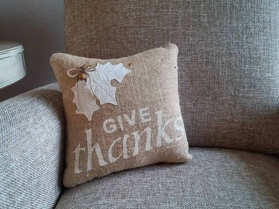 Small natural burlap front pillow featuring give thanks