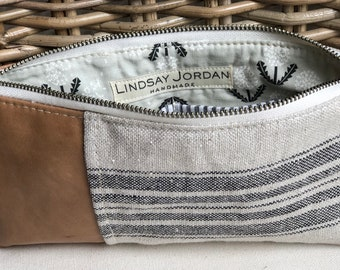 Black, beige grain-sack striped LINEN & tan sheepskin LEATHER wristlet pouch: black, white seersucker pockets   black white dandelion lining