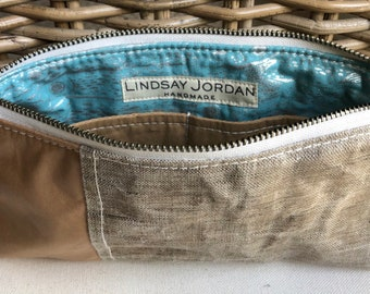 Natural off-white/beige WAXED LINEN tan/natural sheepskin LEATHER wristlet pouch: tan/sand pockets   silver, light blue fish lining