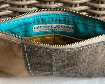 Dark GRAY LINEN & natural/tan colored sheepskin LEATHER wristlet pouch: pumpkin-color pockets   gold and teal blue striped lining