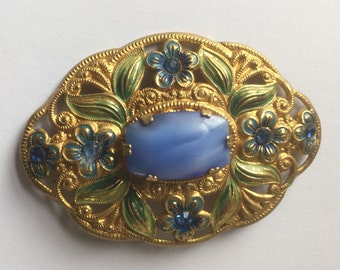Pretty pressed goldtone metal czech pin or brooch with blue moonglow cabachon, pained flowers and rhinestones c.30s/40s