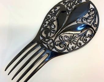 C. 1920s vintage Art Deco hair comb black celluloid with large fleur de lys design