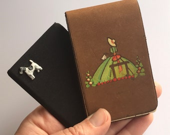 Two unused vintage midcentury jotters and covers - handpainted crinoline lady on suede and grossgrain with terrier emblem