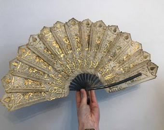 Antique folding Indonesian fan c.1850s - gold shadow dancers on translucent buffalo hide with wooden sticks