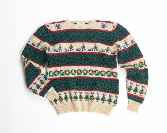 striped wool Christmas sweater | sledding | Christmas trees