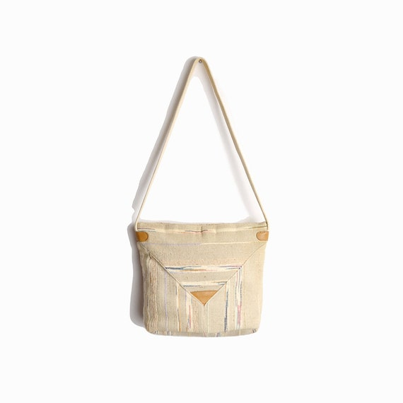 textured cream shoulder bag