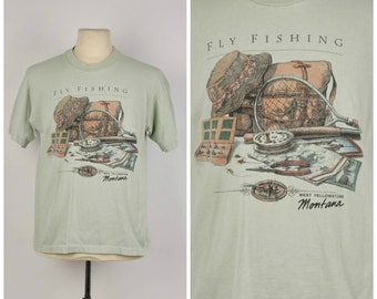 c12d4f53 Fly Fishing West Yellowstone Montana t shirt pale green 90s vintage fish  fisherman tee