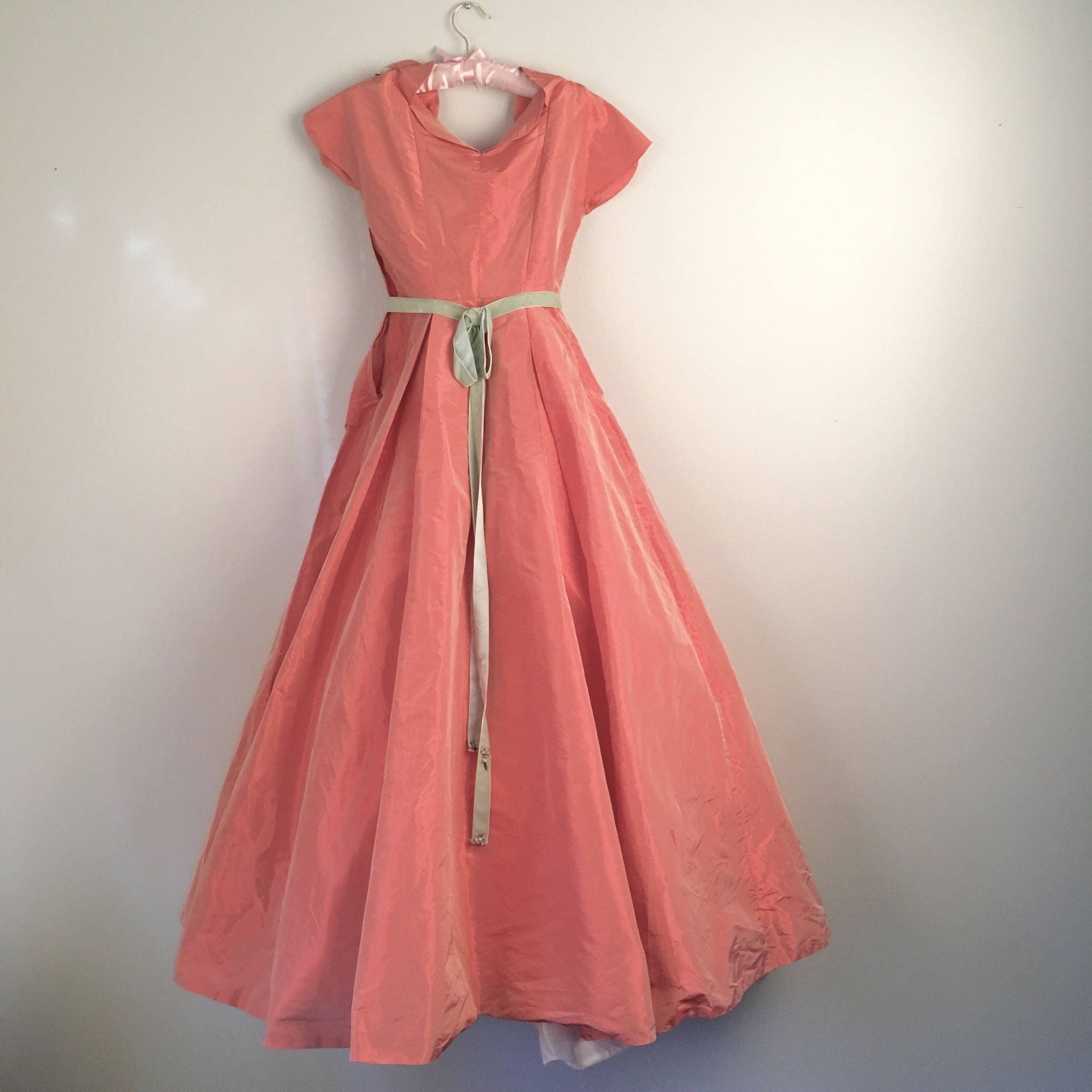 coral taffeta 50s to 60s prom dress with green velvet sash bow