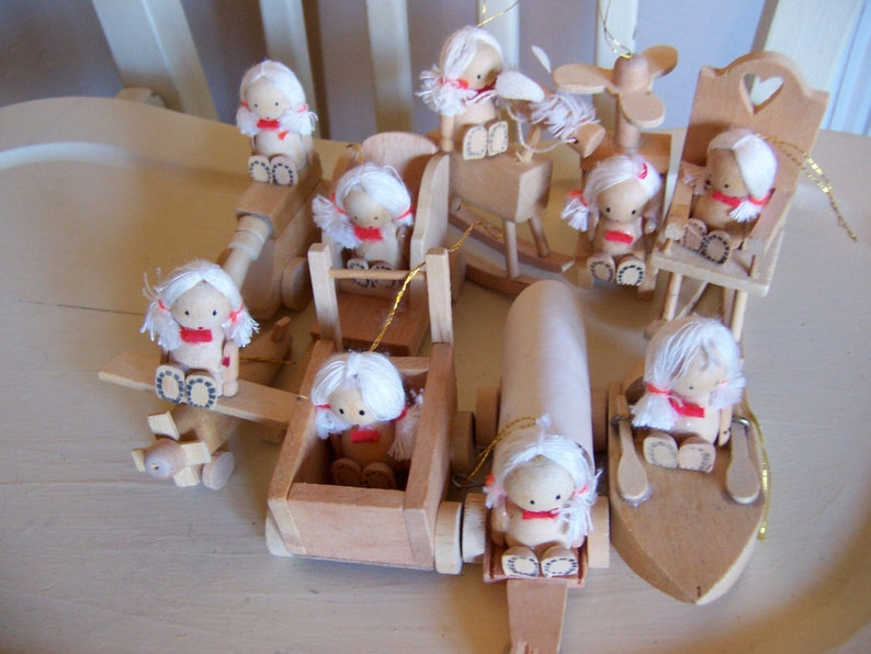nine very cute wooden ornaments