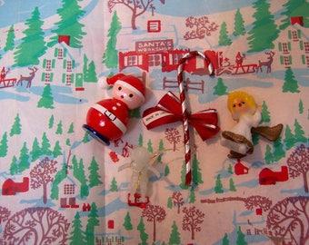 four tiny christmas cuties