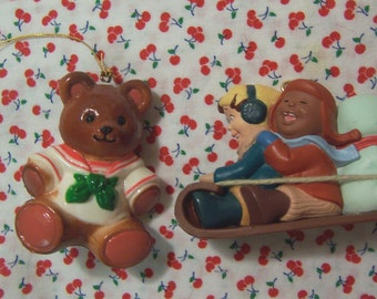 two cute plastic ornaments