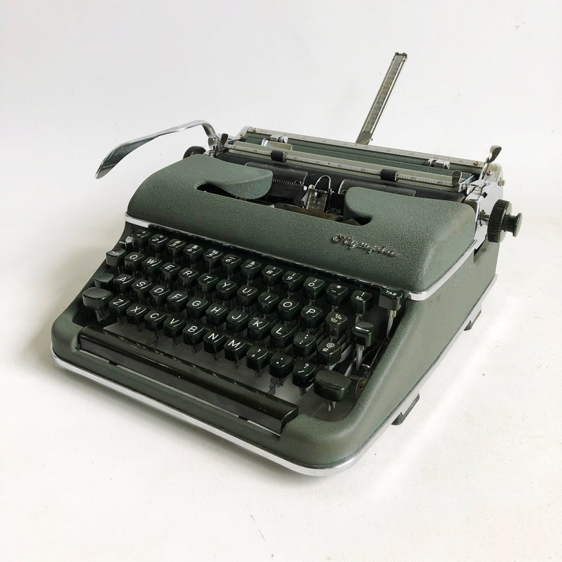 1959 Olympia SM4 De Luxe Portable Typewriter with Dark Green image 0