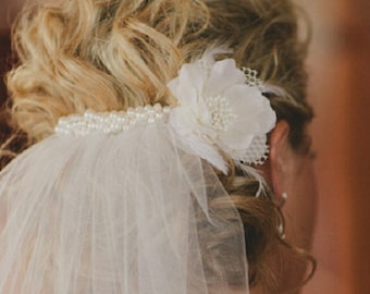 Add clustered swarovski pearls to your veil - veil sold separately and flower not included