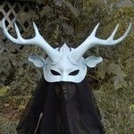 Leather mask of white ghost deer, large wide antlers