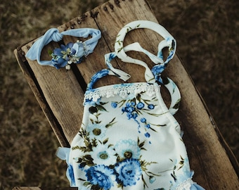 Blue floral and ruffles romper set. sitter size.