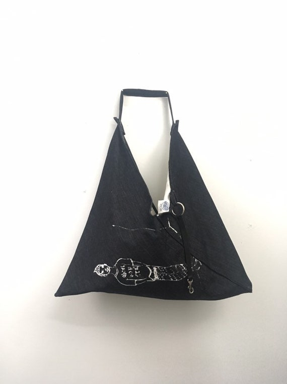 Urban Disciple by Ghoul Boy Zero-Waste Triangle Origami Tote Bag editorial 1/4